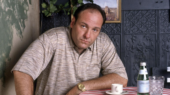 "FILE - This 1999 file photo provided by HBO, shows James Gandolfini as mob boss Tony Soprano, in an episode from the first season of the HBO cable television mob series, ""The Sopranos."" HBO and the managers for Gandolfini say the actor died Wednesday, June 19, 2013, in Italy. He was 51. (AP Photo/HBO, Anthony Neste, File)"