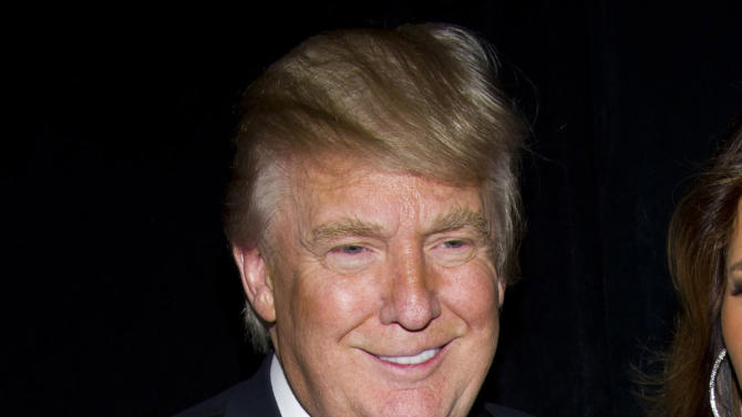 """FILE - In this Nov. 14, 2011 file photo, Donald Trump attends the Friars Club's Testimonial Dinner honoring Larry King, in New York. Trump has launched a new men's fragrance called """"Success."""" (AP Photo/Charles Sykes, file)"""