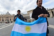 People hold an Argentinian flag on St Peter&#39;s square on March 15, 2013 at the Vatican. Pope Francis on Friday urged the troubled Catholic Church not to give in to &quot;pessimism&quot; and to find new ways of spreading the faith &quot;to the ends of the earth&quot;
