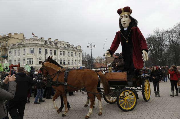 The statue St. Casimir, the patron saint of Lithuania, is seen during the Theatrical carnival procession during the traditional Kaziukas fair, a large annual folk arts and craft fair in Vilnius, Lithu