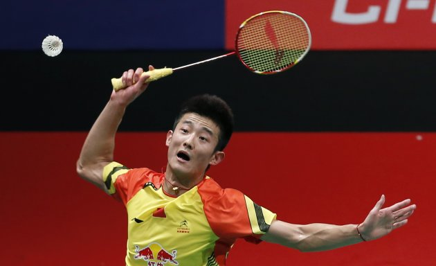 China's Chen smashes against South Korea's Lee during their men's singles match at the finals of the Sudirman Cup World Team Badminton Championships in Kuala Lumpur