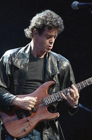 FILE - In a June 13, 1986 file photo, Lou Reed performs during musical number at a benefit in Chicago, for Amnesty International. Reed's literary agent Andrew Wylie says the legendary musician died Sunday morning, Oct. 27, 2013 in Southampton, N.Y., of an ailment related to his recent liver transplant. He was 71. (AP Photo/Fred Jewell, File)