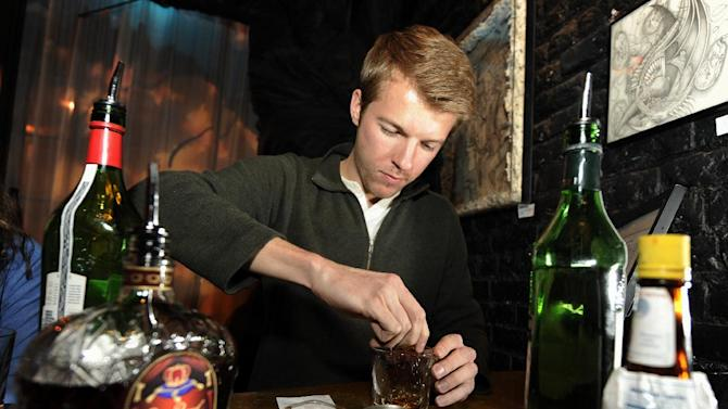 IMAGE DISTRIBUTED FOR CROWN ROYAL - Adam Diskin mixes a cocktail at the Crown Royal Maple Finished Denver Launch party at Double Daughters Salotto, Tuesday, Jan. 22, 2013, in Denver. (Jack Dempsey/AP Images for Crown Royal)