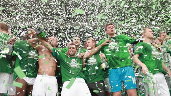 Players of Fuerth celebrate their promotion to the First League after the Second League match between SpVgg Greuther Fuerth and Fortuna Duesseldorf at the Trolli-Arena on April 29, 2012 in Fuerth, Germany. (Photo by Thomas Langer/Bongarts/Getty Images)