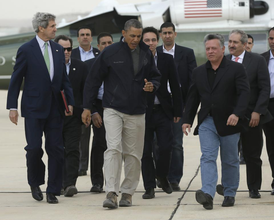 U.S. President Barack Obama, center, talks with King Abdullah II of Jordan, right foreground, as he departs Queen Alia International Airport in Amman, Jordan, Saturday, March 23, 2013.  At left is U.S. Secretary of State John Kerry. (AP Photo/Pablo Martinez Monsivais)