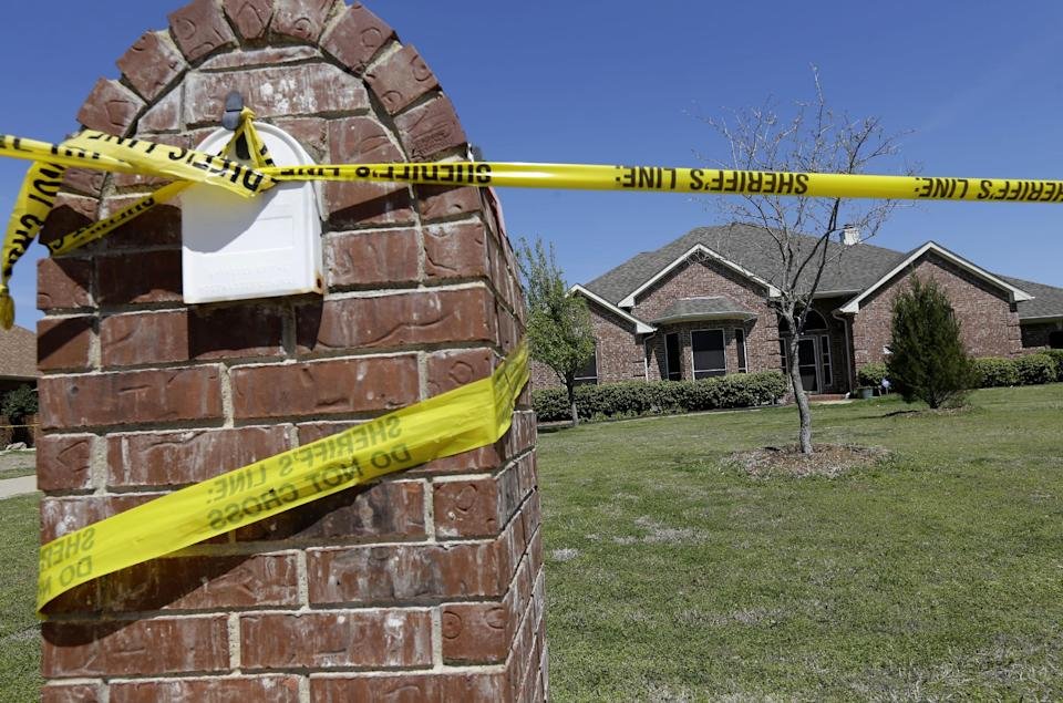 Crime scene tape is seen outside the home of Kaufman County District Attorney Mike McLelland Monday, April 1, 2013, near Forney, Texas. McLelland and his wife Cynthia were murdered at their home Saturday. (AP Photo/Tony Gutierrez)