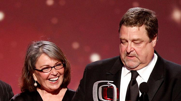 "TV husband and wife Roseanne Barr and John Goodman accept the Innovation Award for ""Roseanne"" during the 6th Annual ""TV Land Awards."""