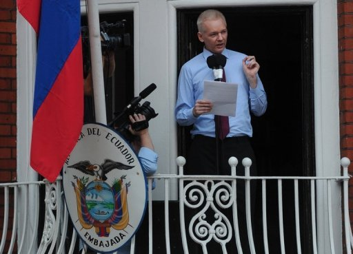 <p>In this file picture taken in August 2012 Wikileaks founder Julian Assange addresses the media and his supporters from the balcony of the Ecuadorian Embassy in London. Assange has a lung condition that could get worse, the South American country's envoy to Britain said.</p>
