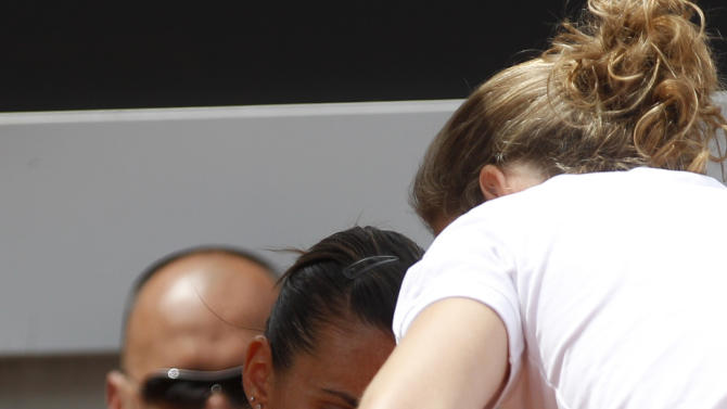 Italy's Flavia Pennetta receives medical treatment during her quarterfinal match against Serena Williams of the US at the Italian Open tennis tournament, in Rome, Friday, May 18, 2012. Pennetta retired from the match. (AP Photo/Alessandra Tarantino)