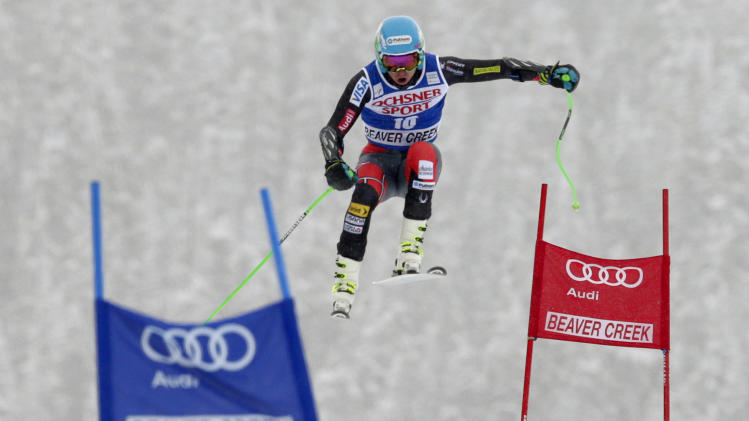 Ted Ligety flies off the Red Tail jump during the men's World Cup super-G skiing event, Saturday, Dec. 7, 2013, in Beaver Creek, Colo.(AP Photo/ Charles Krupa)
