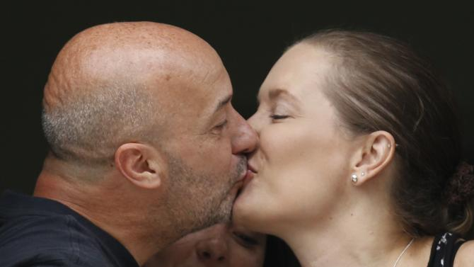 Former Caracas police commissioner Ivan Simonovis kisses his wife Bony Pertinez at their house in Caracas