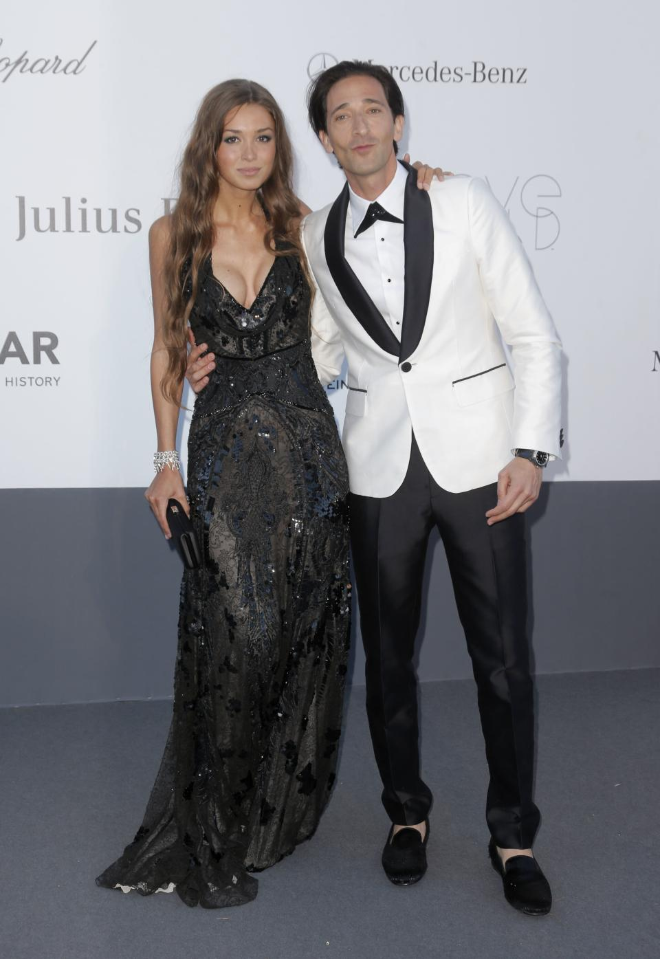 Lara Lieto and Adrien Brody arrive at amfAR Cinema Against AIDS benefit at the Hotel du Cap-Eden-Roc, during the 66th international film festival, in Cap d'Antibes, southern France, Thursday, May 23, 2013. (Photo by Todd Williamson/Invision/AP)