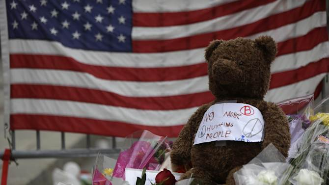 Shown are items left at a makeshift memorial near the finish line of Monday's Boston Marathon explosions, which killed at least three and injured more than 140, Thursday, April 18, 2013, in Boston. (AP Photo/Matt Rourke)