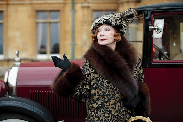 "This undated publicity photo provided by PBS shows Shirley MacLaine as Martha Levinson from the TV series, ""Downton Abbey."" Carnival Films and MASTERPIECE on PBS today announced that six new cast names are joining the series plus the return of Shirley MacLaine for next season's finale. The Hollywood star, who reprises her role as Martha Levinson, proved a huge hit with viewers last year. (AP Photo/PBS, Carnival Film & Television Limited 2012 for MASTERPIECE, Nick Briggs)"