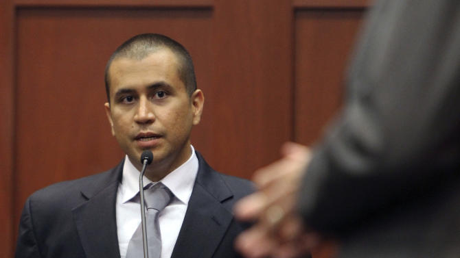 FILE - In this April 20, 2012 file photo, George Zimmerman, left, answers a question from attorney Mark O'Mara during a bond hearing in Sanford, Fla. Zimmerman accused the Sanford police department of corruption more than a year before he shot Trayvon Martin, saying at a public forum the agency covered up the beating of a black homeless man by the son of a white officer. (AP Photo/Orlando Sentinel, Gary W. Green, Pool, File)