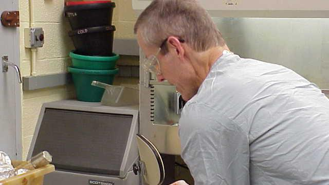 """This undated image attached to an email sent Wednesday, Nov. 14, 2001 by Bruce Ivins shows Ivins handling """"cultures of the now infamous 'Ames' strain of Bacillus anthracis"""" at his lab according to the text of the message. The Government Accountability Office says the science the FBI used to investigate the 2001 anthrax attacks was flawed. The GAO released a report Friday on its findings. The agency didn't take a position on the FBI's conclusion that Army biodefense researcher Bruce Ivins acted alone in making and sending the powdered spores that killed five people and sickened 17 others. The report adds fuel to the debate among experts, including many of Ivins' co-workers at Fort Detrick in Frederick, Maryland, over whether Ivins could have made and mailed the anthrax-filled envelopes. (AP Photo)"""
