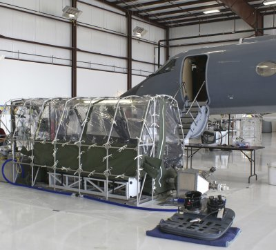 A tentlike structure allows caregivers to treat a single Ebola patient in flight without infectious germs escaping. (CDC via Reuters)