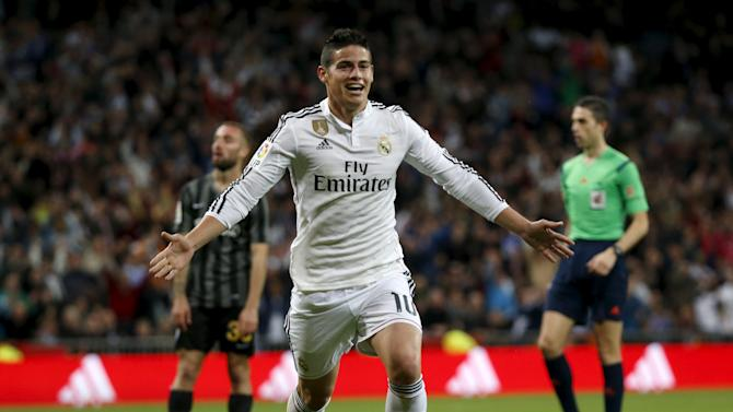Real Madrid's James Rodriguez celebrates his goal against Malaga during their Spanish First Division soccer match at Santiago Bernabeu stadium in Madrid
