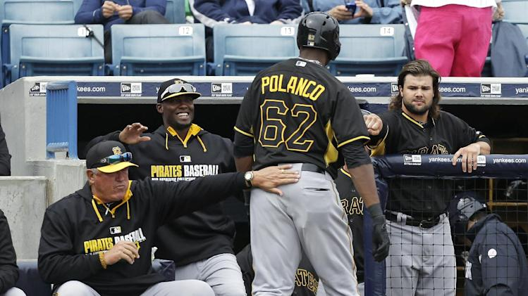 Gregory Polanco, greeted by teammates