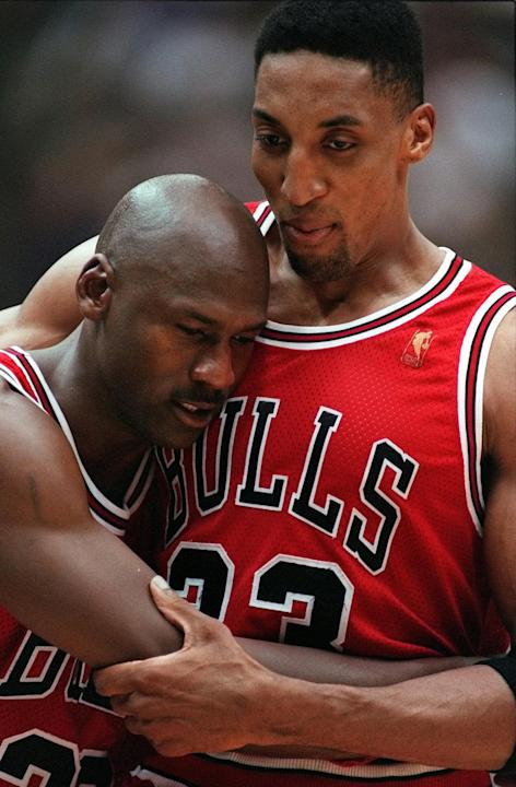 In this June 11, 1997 file photo, Chicago Bulls Scottie Pippen, right, embraces an exhausted Michael Jordan following their 90-88 win in Game 5 of the NBA Finals against the Utah Jazz, in Salt Lake Ci