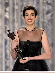 Anne Hathaway accepts the award for outstanding female actor in a supporting role for Les Miserables at the 19th Annual Screen Actors Guild Awards at the Shrine Auditorium in Los Angeles on Sunday, Jan. 27, 2013. (Photo by John Shearer/Invision/AP)