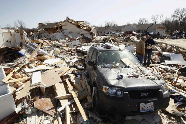 People search for photos and other personal belongings among the rubble caused by a tornado in Harrisburg, Illinois