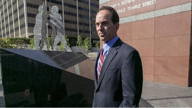 Former Senior KPMG auditor Scott London leaves the Los Angeles Federal Court on Thursday, April 11, 2013. Federal prosecutors and the Securities and Exchange Commission on Thursday filed criminal and civil charges against London, 50, of Agoura Hills, Calif., for conspiracy to commit securities fraud through insider trading. The criminal complaint alleges that London provided confidential information about KPMG clients Herbalife Ltd., Skechers USA Inc., Deckers Outdoor Corp., RSC Holdings and Pacific Capital to Bryan Shaw, a close friend, from late 2010 until last month. (AP Photo/Damian Dovarganes)