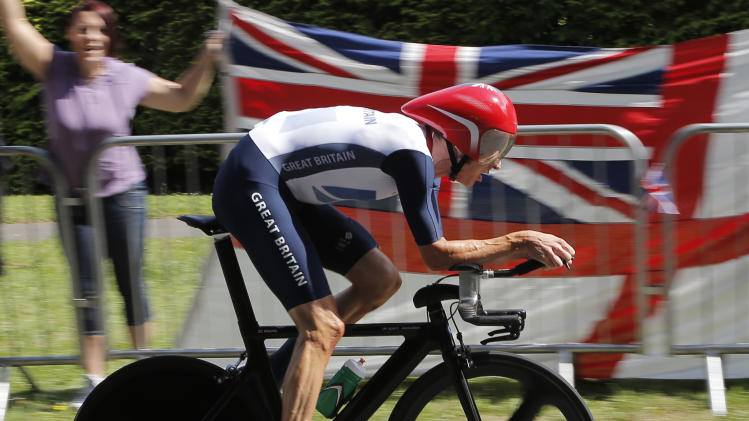 Gold medalist Bradley Wiggins, of Britain, competes in the men's individual time trial cycling event at the 2012 Summer Olympics, Wednesday, Aug. 1, 2012, in London. (AP Photo/Christophe Ena, Pool)