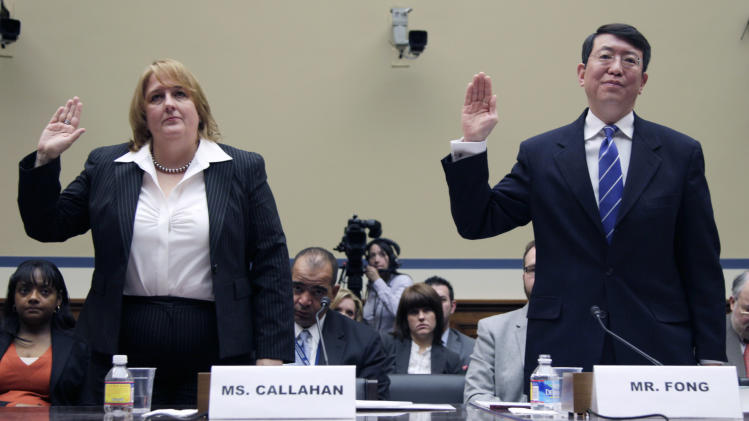 "FILE - In this March 31, 2011, file photo Homeland Security Chief Privacy Officer Mary Ellen Callahan, left, and General Counsel Ivan Fong are sworn in on Capitol Hill prior to testifying about the Freedom of Information Act (FOIA)at a House committee hearing. Acting on his promise to reinvigorate FOIA on his first day in office, Obama told all federal agencies to adopt a ""presumption in favor of disclosure"". According to an Associated Press analysis of federal data over the last three years from 37 of the largest federal departments and agencies, the Obama administration couldn't keep pace with the increasing number of people asking for copies of government documents, emails, photographs and more under the U.S. Freedom of Information Act.  (AP Photo/Carolyn Kaster, File)"
