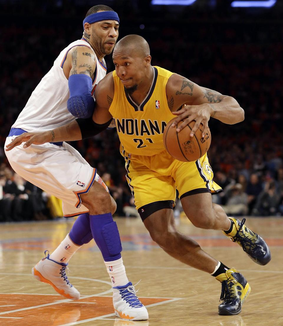 Indiana Pacers forward David West (21) drives past New York Knicks forward Kenyon Martin (3) in the second quarter of Game 1 of their second-round NBA basketball series at Madison Square Garden in New York, Sunday, May 5, 2013.  (AP Photo/Kathy Willens)