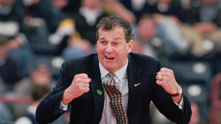 FILE - This March 14, 1996 file photo shows Connecticut coach Jim Calhoun reacting to a call in the second half against Colgate in the first round of the NCAA Southeast Regional in Indianapolis. Calhoun is officially retiring, Thursday, Sept. 13, 2012,  as men's basketball coach at Connecticut after a 40-year college career and three national championships.  (AP Photo/Phil Myers, File)