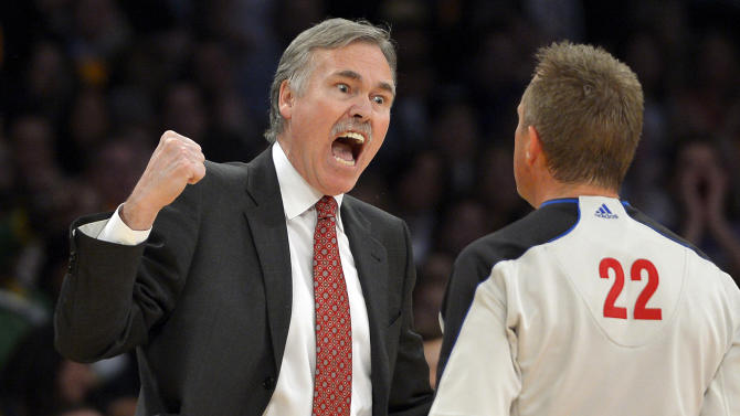 Los Angeles Lakers head coach Mike D'Antoni, left, yells at referee Bill Spooner during the first half of their NBA basketball game against the Los Angeles Clippers, Thursday, Feb. 14, 2013, in Los Angeles.  (AP Photo/Mark J. Terrill)