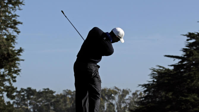 Tiger Woods hits a drive on the fourth hole during a practice round for the U.S. Open Championship golf tournament Tuesday, June 12, 2012, in San Francisco. (AP Photo/Charlie Riedel)