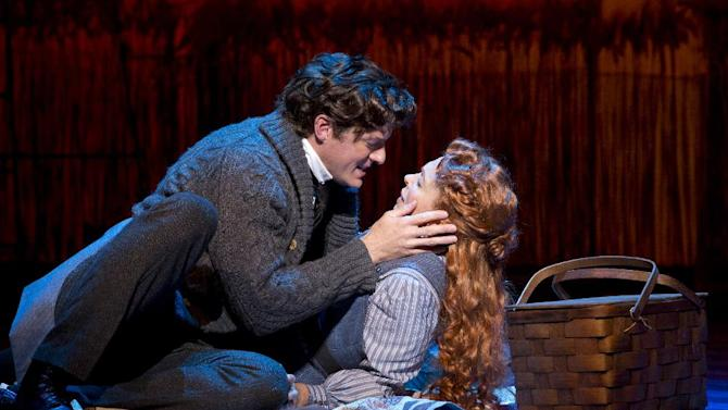 """This theater image released by The Publicity Office shows Edward Watts, left, and Carolee Carmello during a performance of the musical """"Scandalous: The Life and Trials of Aimee Semple McPherson,"""" at the Neil Simon Theatre in New York. (AP Photo/The Publicity Office, Jeremy Daniel)"""