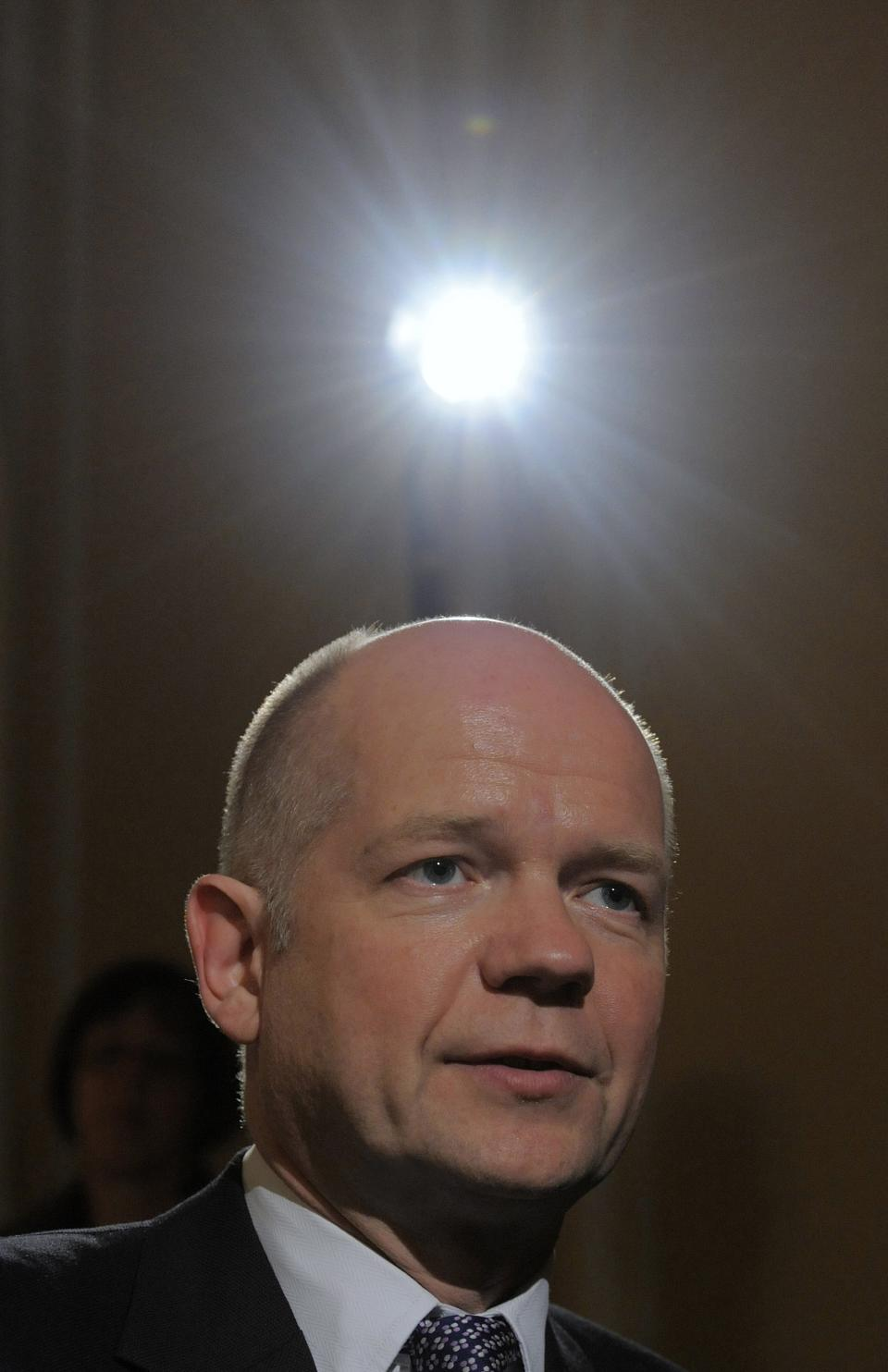 Britain's Foreign Minister William Hague speaks during an interview with The Associated Press and BBC during the International Conference on Security Policy at the hotel 'Bayerischer Hof' in Munich, southern Germany, Friday, Feb. 4, 2011. (AP Photo/Jens Meyer)