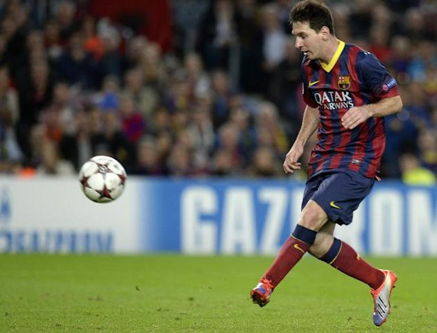 Barcelona forward Lionel Messi scores during a UEFA Champions league match against AC Milan at the Camp Nou stadium in Barcelona on November 6, 2013