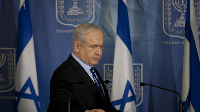 """Israel's Prime Minister Benjamin Netanyahu looks on after delivering a statement to the media at Hakirya a military base in Tel Aviv, Israel, Wednesday, Nov. 14, 2012. Israel's prime minister says the military is prepared to broaden its operation against Hamas targets in Gaza. Benjamin Netanyahu says Israel cannot tolerate continued rocket attacks against its citizens. In his first comments since Israel killed the commander of the Hamas military wing, Netanyahu said Wednesday that Israel is """"prepared to expand the operation"""". (AP Photo/Ariel Schalit)"""