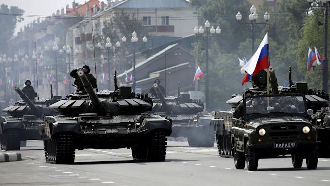 Russian servisemen drive T-72 main battle tanks during military parade to mark 70th anniversary of end of World War Two in Yuzhno-Sakhalinsk