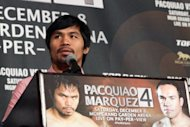 Filipino boxer Manny Pacquiao speaks to the media at a press conference in California on September 17. Pacquiao says this time he won't make the mistake of underestimating Juan Manuel Marquez when they square off in the non-title fight