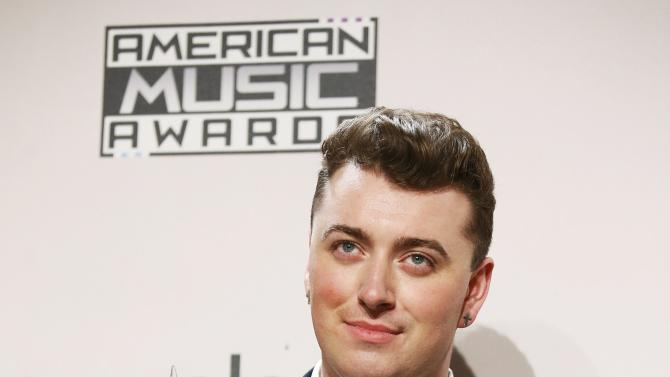 Sam Smith poses with his award during the 42nd American Music Awards in Los Angeles