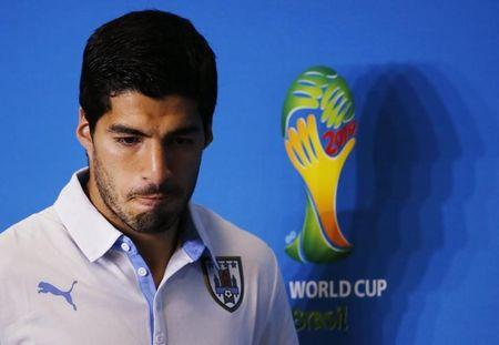 Uruguay's national soccer team player Luis Suarez attends a news conference prior a training session at the Dunas Arena soccer stadium in Natal