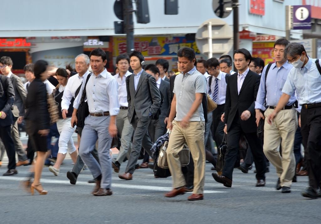 Japan clobbered by weak inflation, businesss confidence