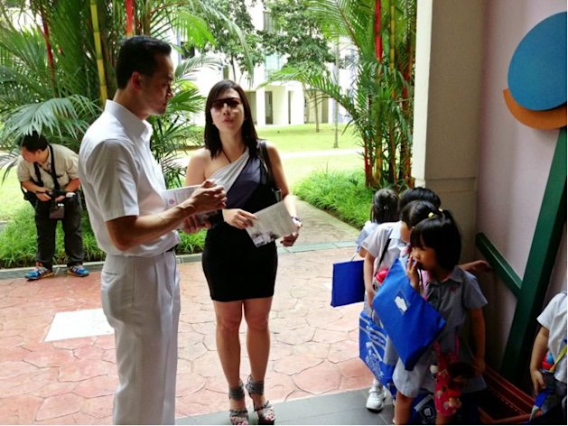 PAP&#39;s Dr Koh Poh Koon speaks to a Punggol resident, Vena Xie,  on the issue of childcare centres.