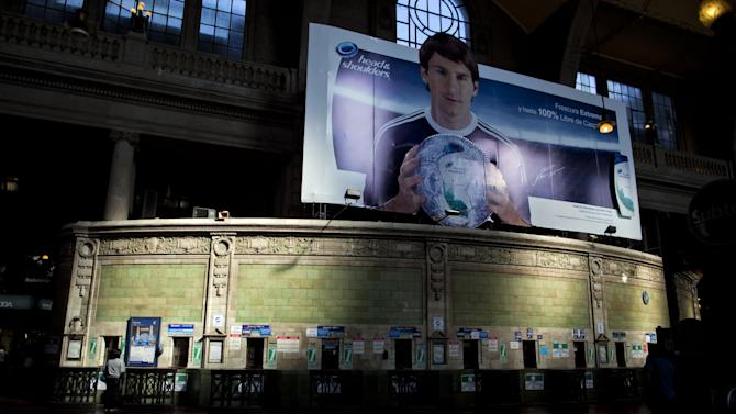 The ticket offices of the Retiro train station stand empty where a poster of Argentina's soccer player Lionel Messi hangs above during a nationwide 24-hour general strike in Buenos Aires, Argentina, Tuesday, Nov. 20, 2012. Argentine President Cristina Fernandez is facing a nationwide strike, led by union bosses who once were her most steadfast supporters. Many trains and bus lines are paralyzed; banks, courts and schools are closed; airlines have canceled flights and small groups of people have blocked highways in about a dozen places around the capital. (AP Photo/Natacha Pisarenko)