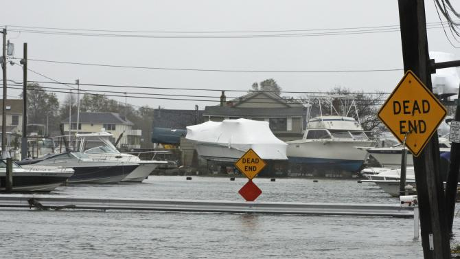 Water from Hurricane Sandy floods streets Monday, Oct. 29, 2012, in Seaford, N.Y. Hurricane Sandy continued on its path Monday, as the storm forced the shutdown of mass transit, schools and financial markets, sending coastal residents fleeing, and threatening a dangerous mix of high winds and soaking rain.  (AP Photo/Frank Franklin II)