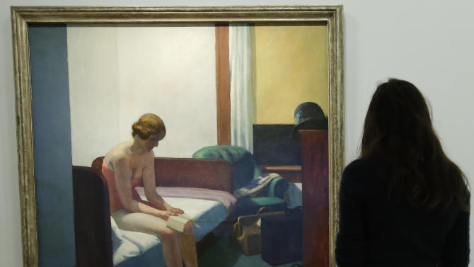 "A woman looks at ""Hotel Room, 1931"" as part of the retrospective of Edward Hopper, one of the great American 20th century artists at Paris' Grand Palais Museum, in Paris, Monday, Oct. 8, 2012.  This major Hopper retrospective reveals that the 20th century painter known for his rendering of American life, also drew inspiration from France, and includes some 128 Hopper works, such as the masterpieces ""Nighthawks"" and ""Soir Bleu"". (AP Photo / Francois Mori)"