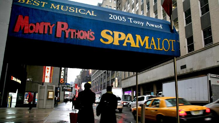"FILE- Pedestrians walk under the marquee of the Broadway show ""Monty Python's Spamalot"" at the Shubert Theatre in New York, in this file photo dated Tuesday, Nov. 25, 2008. As a global hit musical, ""Spamalot"" was a spin off from the 1975 movie ""Monty Python and the Holy Grail"" and enjoyed long runs on Broadway in NY as well as other cities around the world, and is still playing in London's West End, but a British court on Friday July 5, 2013, has awarded the producer of the Holy Grail movie, Mark Forstater, as bigger share of royalties from the Python troupe. (AP Photo/Craig Ruttle, FILE)"