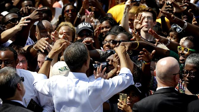 President Barack Obama shakes hands with supporters after speaking at a campaign event at Norfolk State University, Tuesday, Sept. 4, 2012, in Norfolk, Va. (AP Photo/Pablo Martinez Monsivais)
