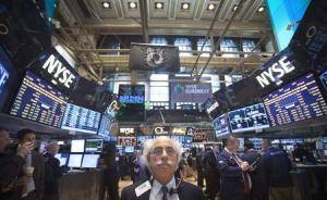 Trader Tuchman works on the floor of the New York Stock Exchange in New York