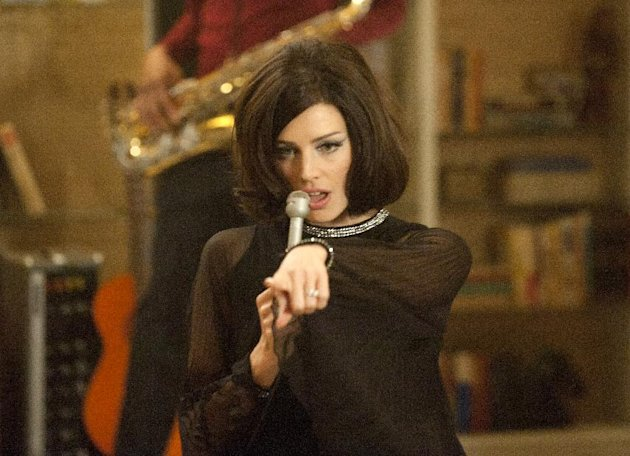 This image released by AMC shows Jessica Pare as Megan Draper performing a French song in a scene from the season five premiere episode of &quot;Mad Men,&quot; where Megan surprises her husband Don with a birthday party. On Thursday, July 19, 2012, the program received a total of 17 Emmy nominations including best actress in a drama series for Elisabeth Moss and best actor for Jon Hamm. The 64th annual Primetime Emmy Awards will be presented Sept. 23 at the Nokia Theatre in Los Angeles, hosted by Jimmy Kimmel and airing live on ABC. (AP Photo/AMC, Ron Jaffe)